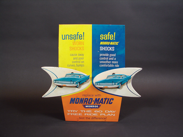 Stellar early 1960s Monroe Shock Absorbers tin animated counter-top display sign. - Front 3/4 - 72246