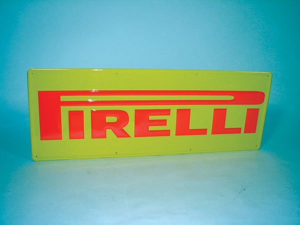 N.O.S 1960s Pirelli tires single -sided tin embossed garage sign. - Front 3/4 - 72288