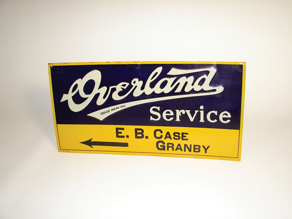 5263 - N.O.S. 1930s Overland Service single-sided tin embossed garage sign. - Front 3/4 - 72290