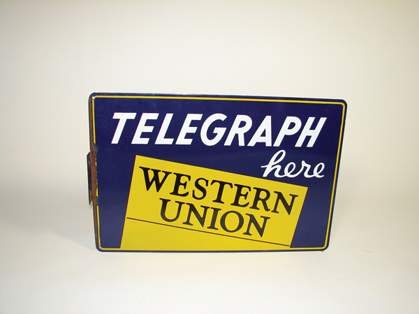 "Very nice 1940s Western Union ""Telegraph Here"" double-sided porcelain general store sign. - Front 3/4 - 72350"