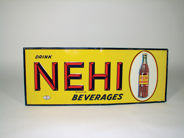 N.O.S. late 20s-early 30s Nehi Beverages soda tin sign with bottle graphic. - Front 3/4 - 72351