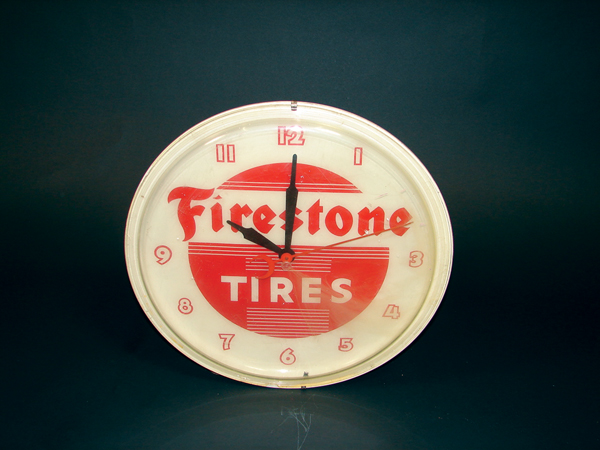 1960s Firestone Tires plastic faced garage clock. - Front 3/4 - 72452