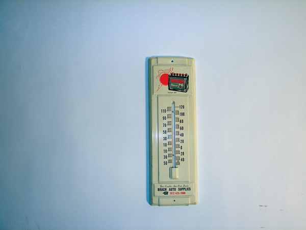Neat Trojan Batteries tin garage thermometer with battery graphic. - Front 3/4 - 72453