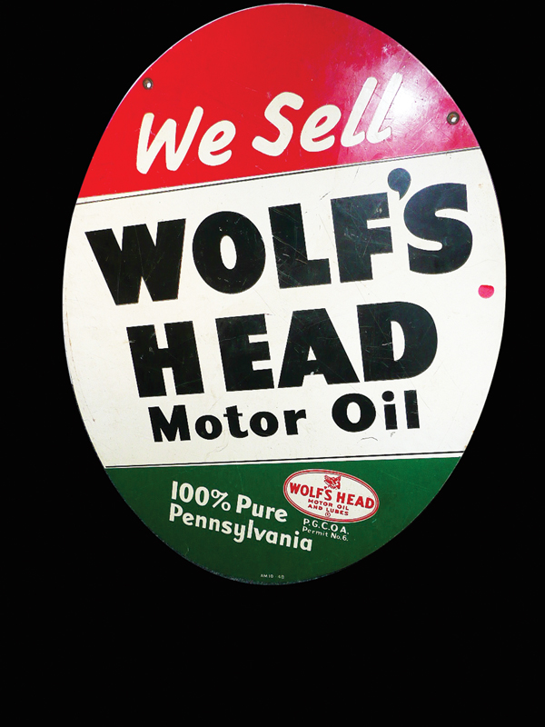 1950s Wolfs Head Motor Oil double-sided tin garage sign. - Front 3/4 - 72473