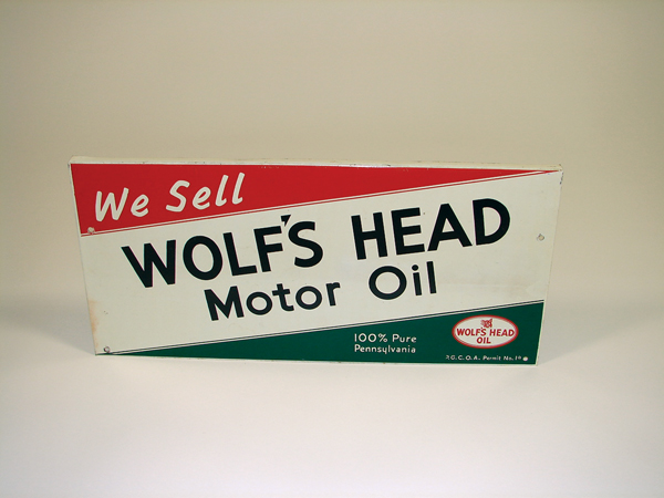 1950s Wolfs Head Motor Oil single-sided tin garage sign. - Front 3/4 - 72476
