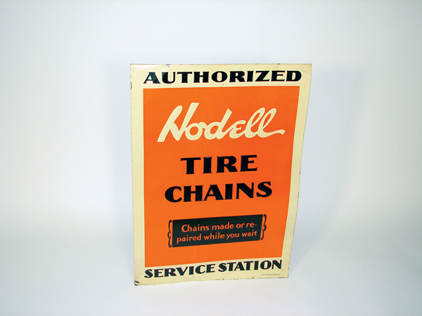 Remarkable N.O.S. 1920s Hodell Tire Chains tin garage sign. - Front 3/4 - 72480