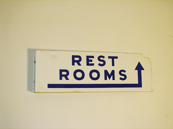 1950s Rest Rooms double-sided porcelain service station sign with arrow. - Front 3/4 - 72484