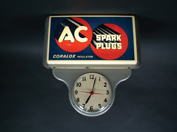 Neat 1950s AC Spark Plugs light-up garage clock. - Front 3/4 - 72519