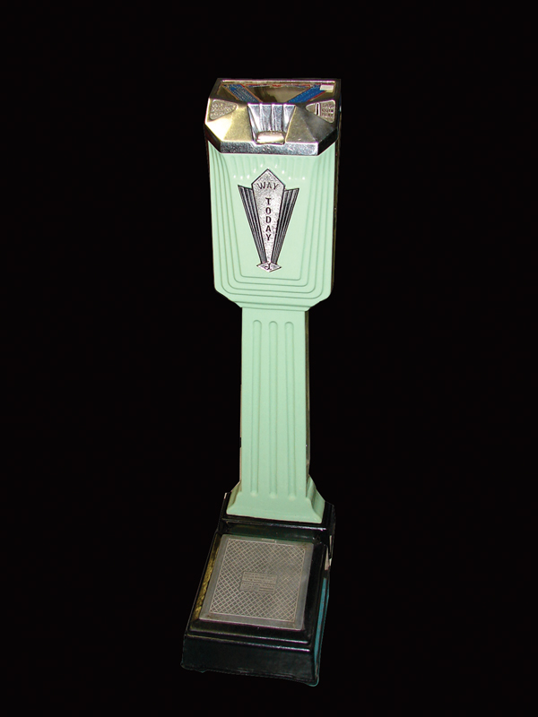 1930s Jennnings coin-operated penny scale in striking green porcelain. - Front 3/4 - 72522