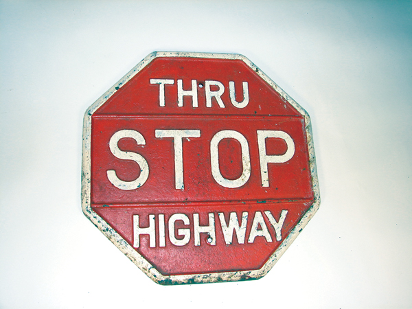 "Very early and heavy Stop ""Thru Highway"" cast iron road sign. - Front 3/4 - 72523"
