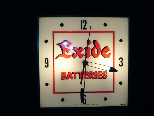 Late 50s-early 60s Exide Batteries glass faced light up garage clock. - Front 3/4 - 72527