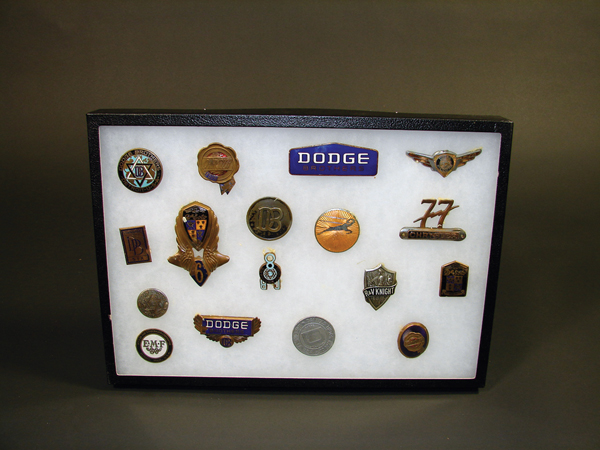 Nice display of 17 vintage auto badges circa 1920s-30s. - Front 3/4 - 72532