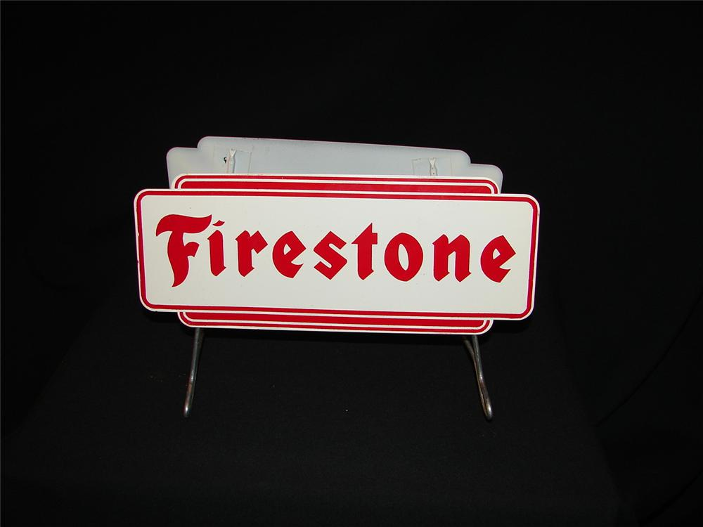 N.O.S. 1950s-60s Firestone Tires double-sided tin tire display sign. - Front 3/4 - 73446
