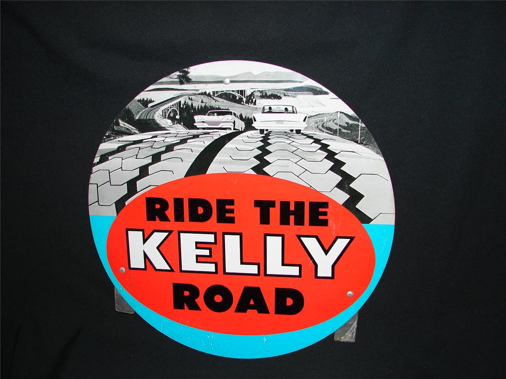 1961 Kelly Tires single-sided tin station sign with period vehicle graphics. - Front 3/4 - 73455