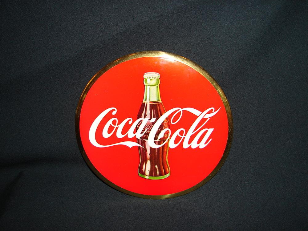 N.O.S. 1950s Coca-Cola celluloid disc sign with built in easel back.  Condition: Near Mint - Front 3/4 - 73463