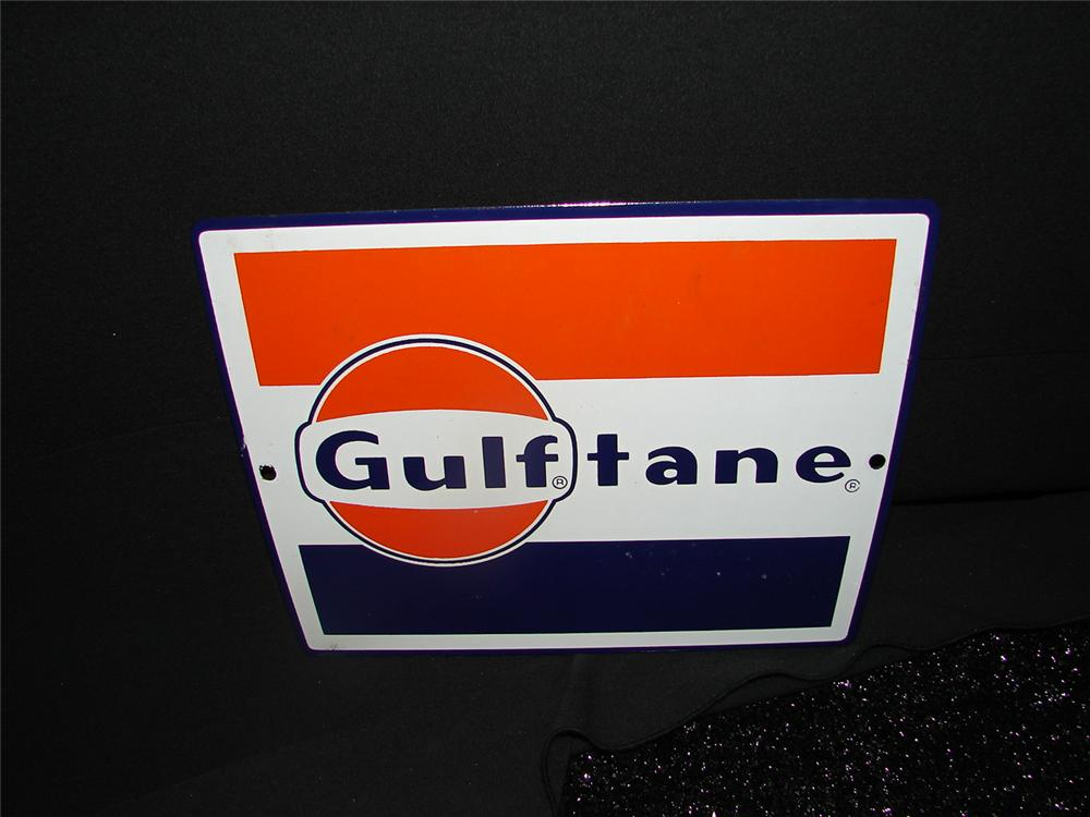 N.O.S. Gulftane porcelain pump plate sign.  Condition: Near Mint - Front 3/4 - 73891