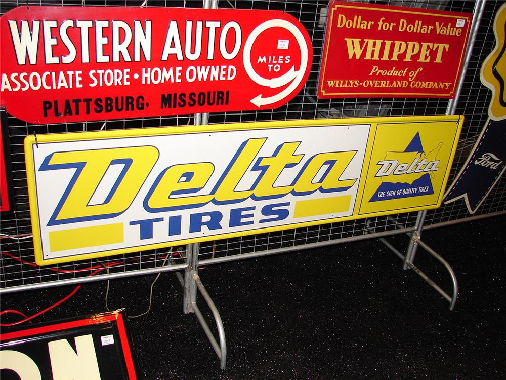 N.O.S. early 1960s Delta Tires single-sided tin horizontal garage sign.  Condition: Near Mint - Front 3/4 - 73922