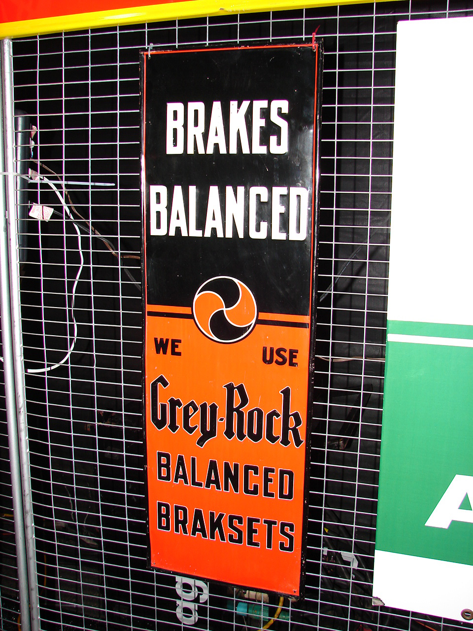 N.O.S. 1930s Grey Rock embossed tin garage sign.  Very clean! - Front 3/4 - 74861