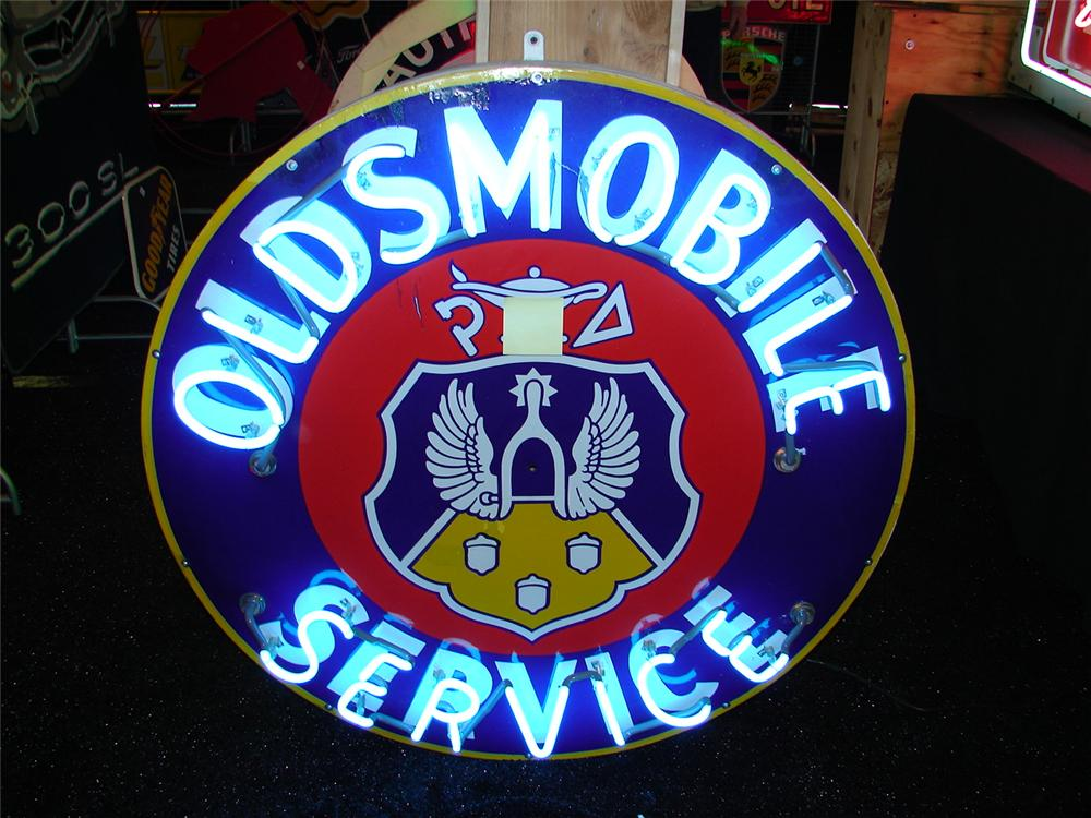 Late 40s-early 50s Oldsmobile double-sided porcelain dealership sign with neon. - Front 3/4 - 74871