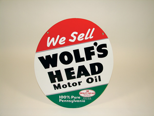N.O.S. 1950s Wolfs Head Motor Oil double-sided tin garage sign. - Front 3/4 - 75552