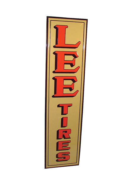 N.O.S. 1947 Lee Tires self-framed vertical tin garage sign. - Front 3/4 - 75566