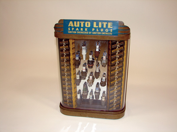 Impressive  Late 20s-early 30s Auto-Lite Spark plugs counter-top display cabinet filled with period spark plugs from various... - Front 3/4 - 75568