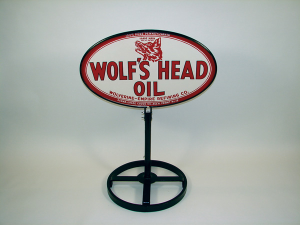 Never before seen N.O.S. 1940s Wolfs Head Motor Oil double-sided tin curb sign. - Front 3/4 - 75573