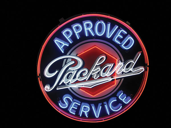 Astounding 1930s Packard Automobiles single-sided porcelain dealership sign with animated neon. - Front 3/4 - 75584