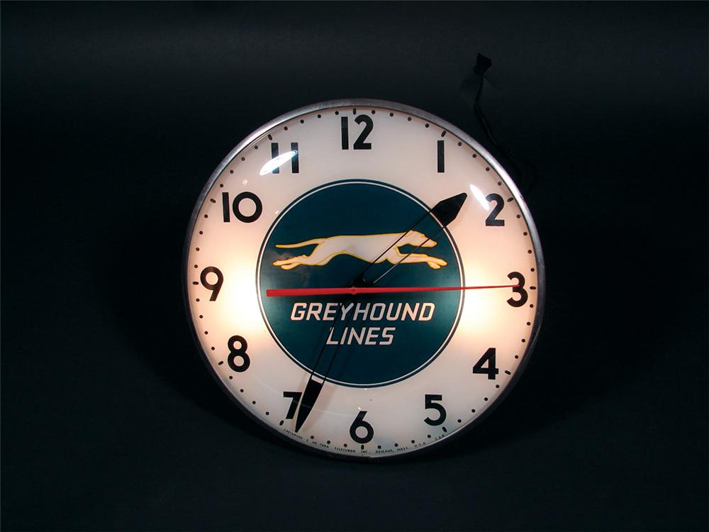 Hard to find late 40s-early 50s Greyhound Bus Lines light-up depot clock made by Telechron. - Front 3/4 - 75765