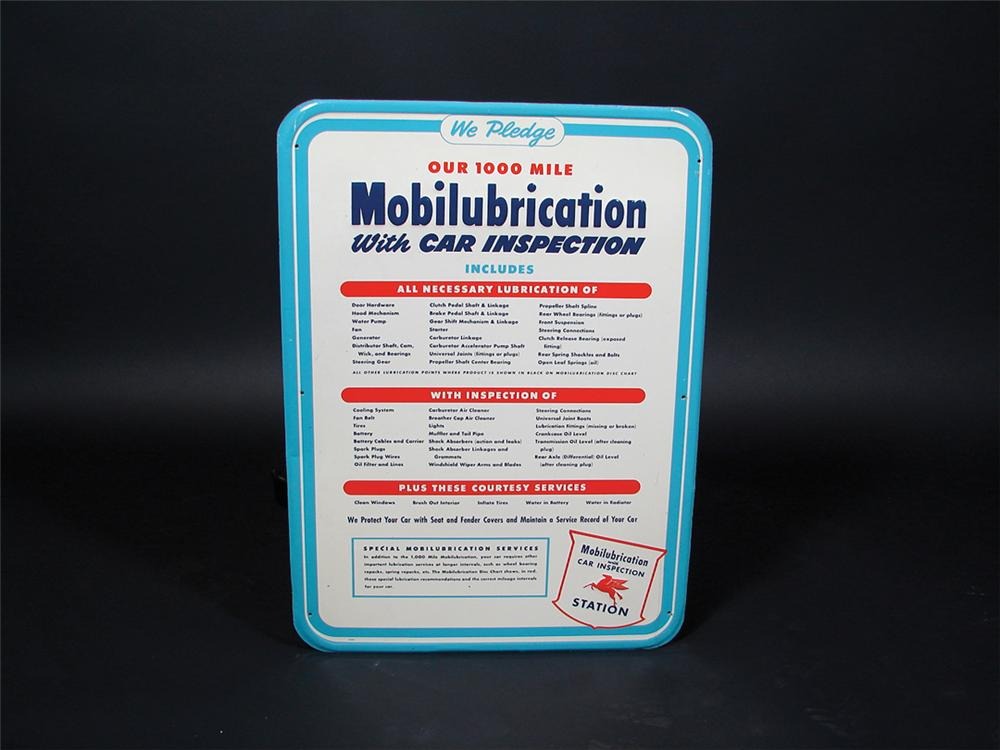 N.O.S. late 50s Mobil Lubrication single-sided tin station sign with embossed lettering. - Front 3/4 - 75784