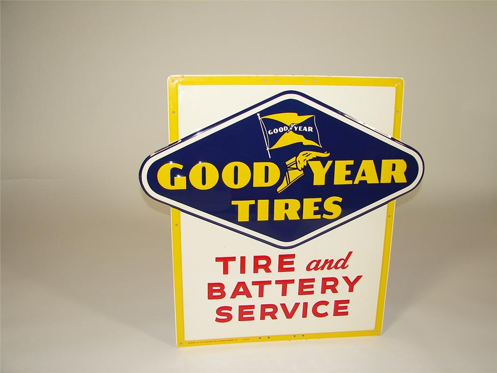 "Superlative N.O.S. 1954 Goodyear Tires ""Tire and Battery Service"" single-sided embossed tin garage sign. - Front 3/4 - 79348"
