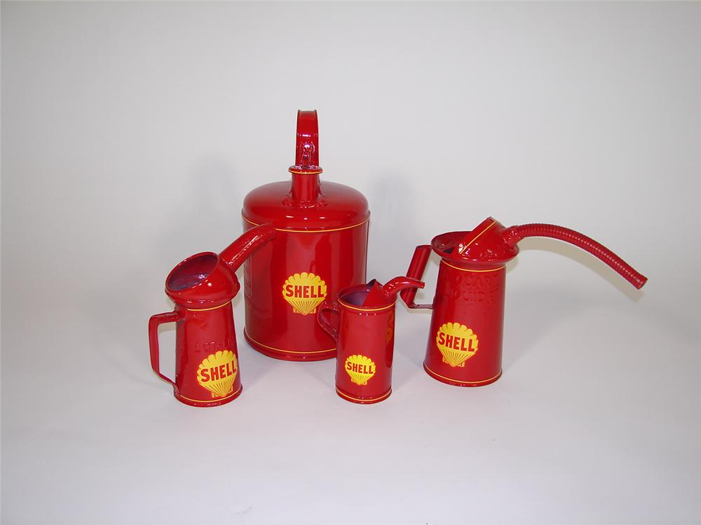Lot of four restored 1920s-30s Shell Oil service station bulk oil and lube cans. - Front 3/4 - 79368