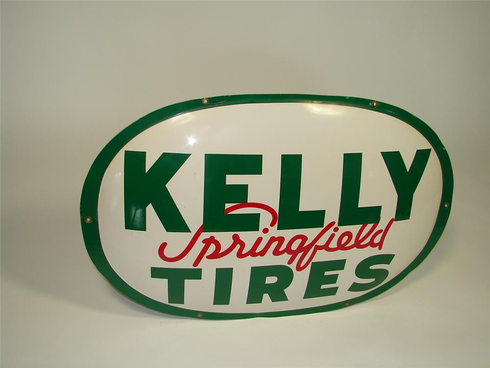 Impressive 1951 Kelly Springfield Tires oval shaped die-cut tin garage sign with convex attributes. - Front 3/4 - 79409