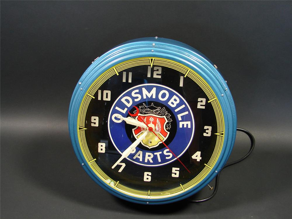 Elusive 1940s Oldsmobile Parts neon dealership clock. - Front 3/4 - 79425