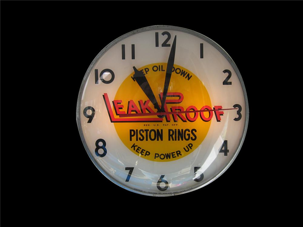 "Clean 1950s Leak Proof Piston Rings ""Keep Power Up"" glass faced light up garage clock. - Front 3/4 - 79543"
