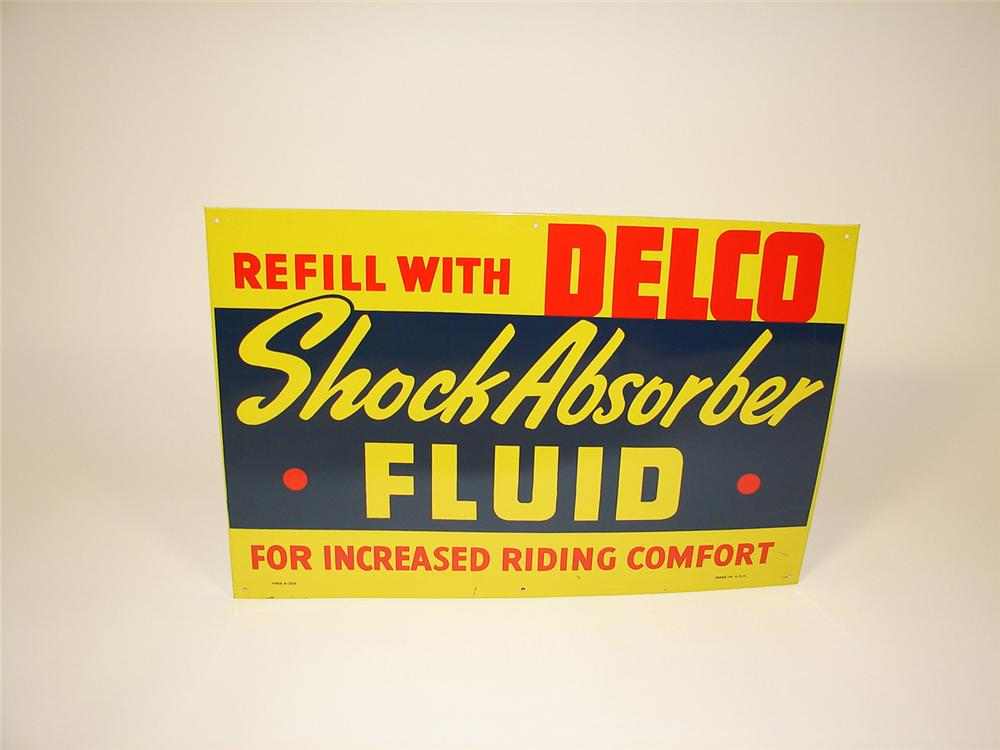 N.O.S. 1950s Delco Shock Absorber Fluid single-sided tin garage sign. - Front 3/4 - 81474
