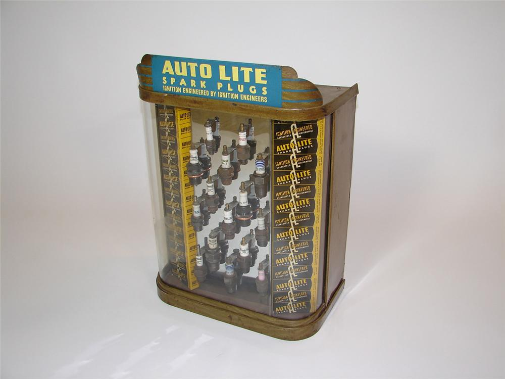 Impressive late 20s-early 30s Ford Auto-Lite Spark Plugs counter-top display cabinet filled with period spark plugs from var... - Front 3/4 - 81520