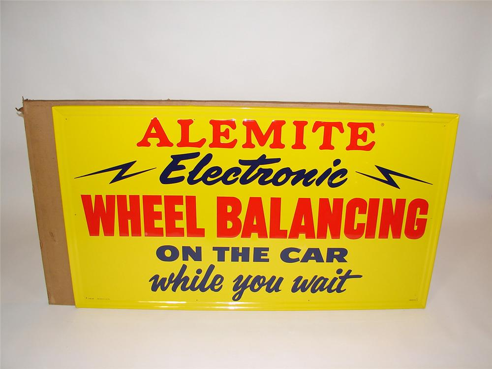 N.O.S. 1950s Alemite Electronic Wheel Balancing single-sided tin embossed garage sign. Still in the original shipping box!! - Front 3/4 - 81539