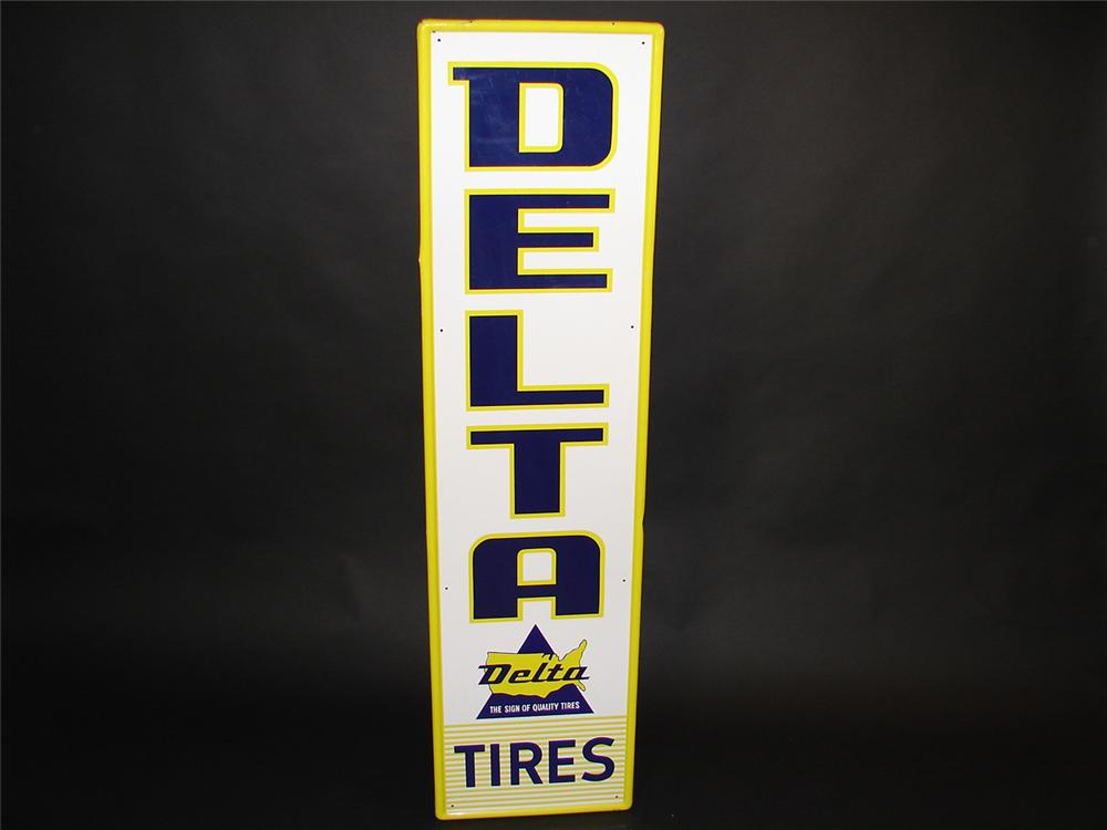 N.O.S. 1960s Delta Tires single-sided tin vertical embossed garage sign. - Front 3/4 - 81674