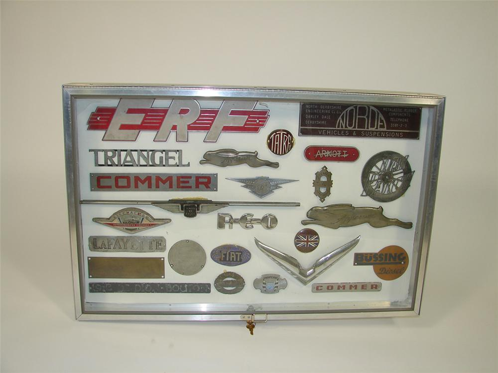 Display case filled with vintage car and truck badges. - Front 3/4 - 82271