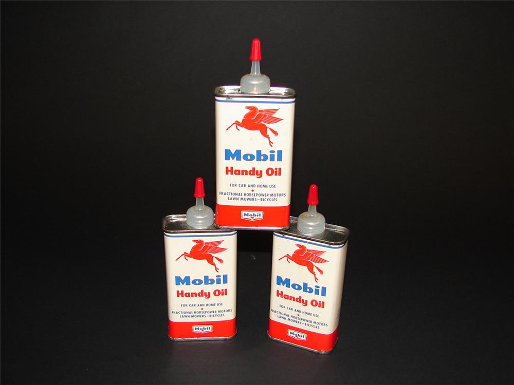 Lot of three N.O.S. 1950s Mobil Handy Oiler four ounce tins with spouts. - Front 3/4 - 82383