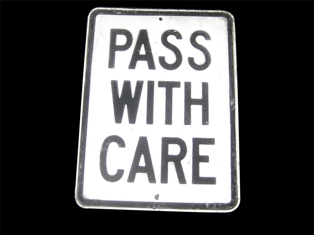 "1940s ""Pass with Care"" highway road sign with embossed lettering. - Front 3/4 - 82388"