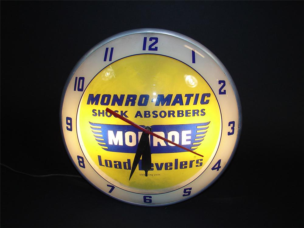 1950s-60s Monroe Shock Absorbers double-bubble light-up garage clock. - Front 3/4 - 82398