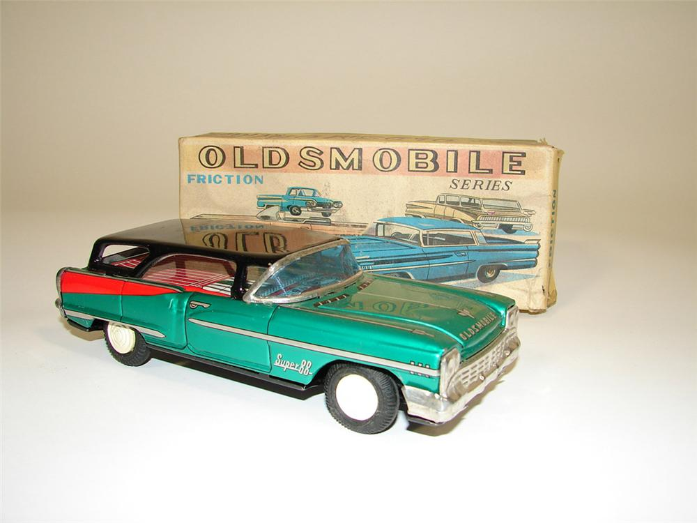 N.O.S. 1960s Oldsmobile Super 88 tin litho friction drive wagon still in the original box. - Front 3/4 - 82417