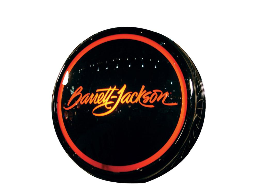 Stylish Barrett-Jackson glass faced light-up sign presented in a hand crafted powder-coated aluminum body. - Front 3/4 - 82483