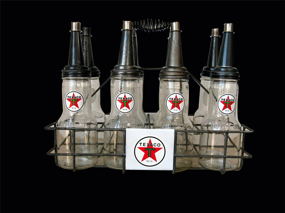 Sharp 1940s Texaco service station fuel island bottle rack with eight glass bottles. - Front 3/4 - 82552