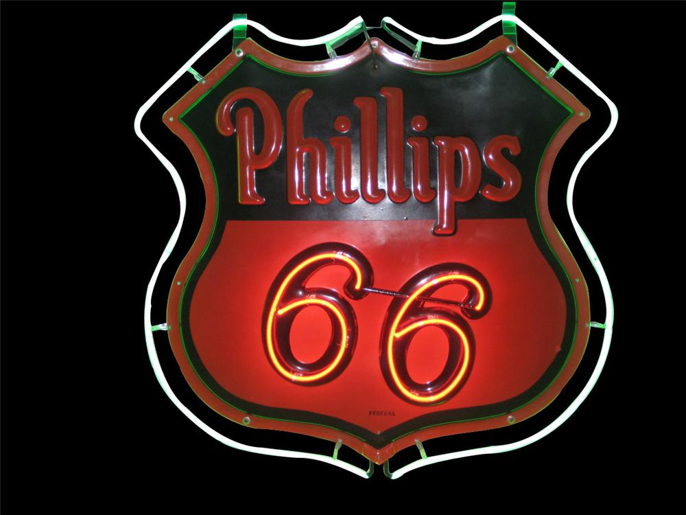 Iconic 1930s Phillips 66 double-sided embossed porcelain neon service staiton sign. - Front 3/4 - 82564