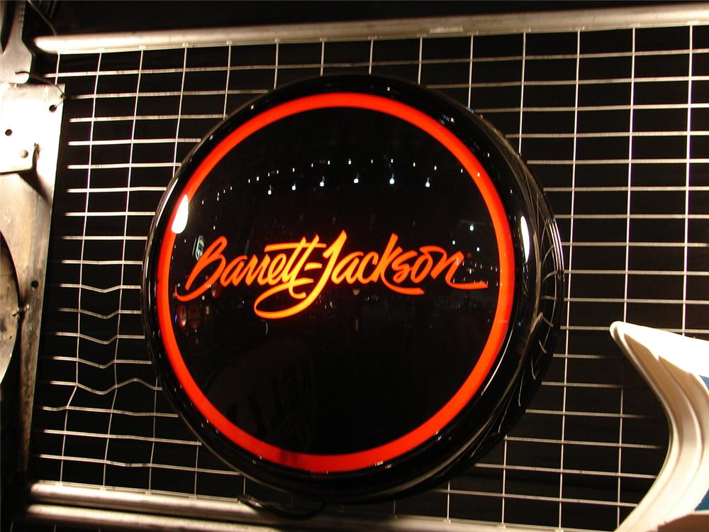Stylish Barrett-Jackson glass faced light-up sign presented in a hand crafted powder-coated aluminum body. - Front 3/4 - 88599