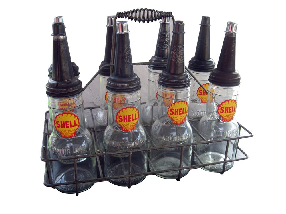 1940s Shell service station oil bottle rack with eigh glass bottles. - Front 3/4 - 89254
