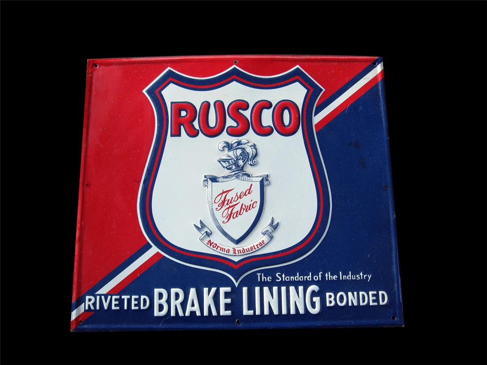 1950s Rusco Brake Lining single-sided tin embossed garage sign. - Front 3/4 - 89263